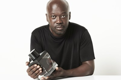 Sir David Adjaye with the decanter he designed for Gordon & MacPhail, comprising the oldest Scotch whisky ever bottled, the Generations 80-Years-Old from Glenlivet Distillery